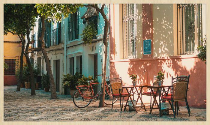 Foto Kunst Schilderijen: Bomen Terrasje Pastelkleuren Huizen Travel Stories Wandkraft Collectie